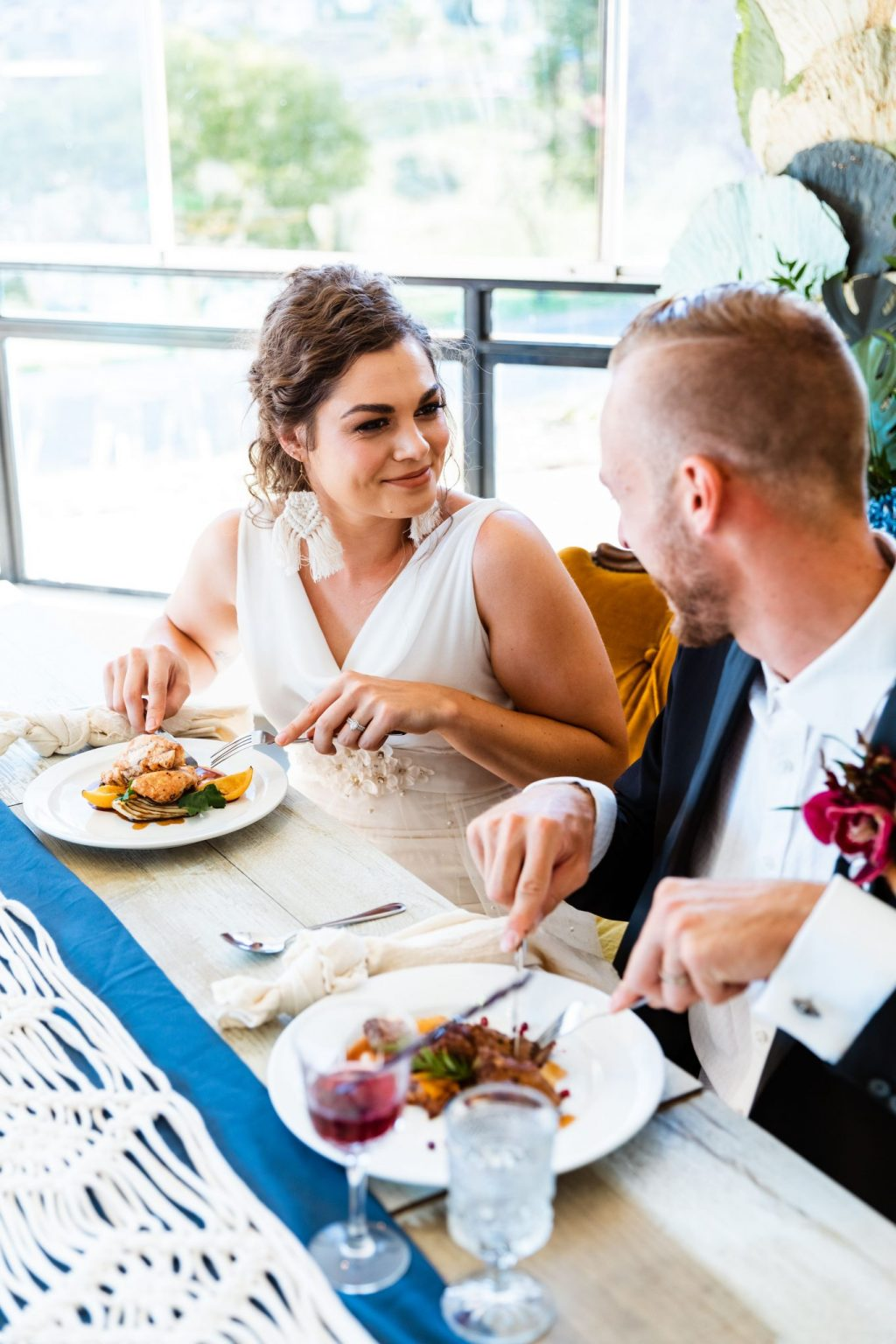 Wedding couple eating a meal