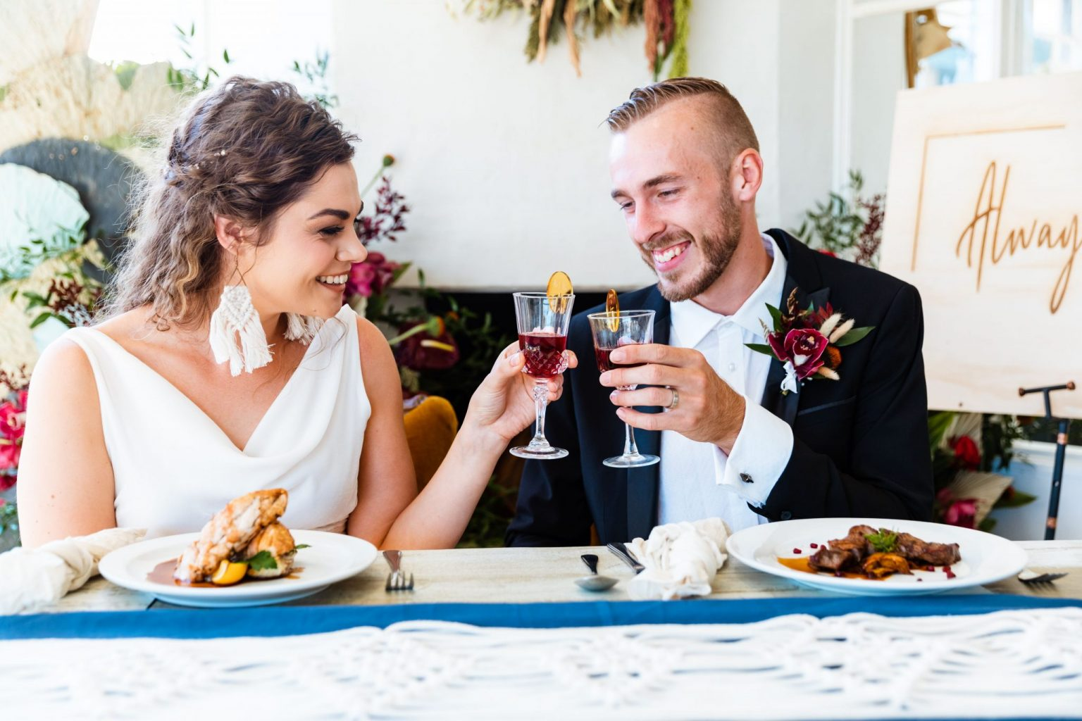 Wedding couple enjoying wine and food