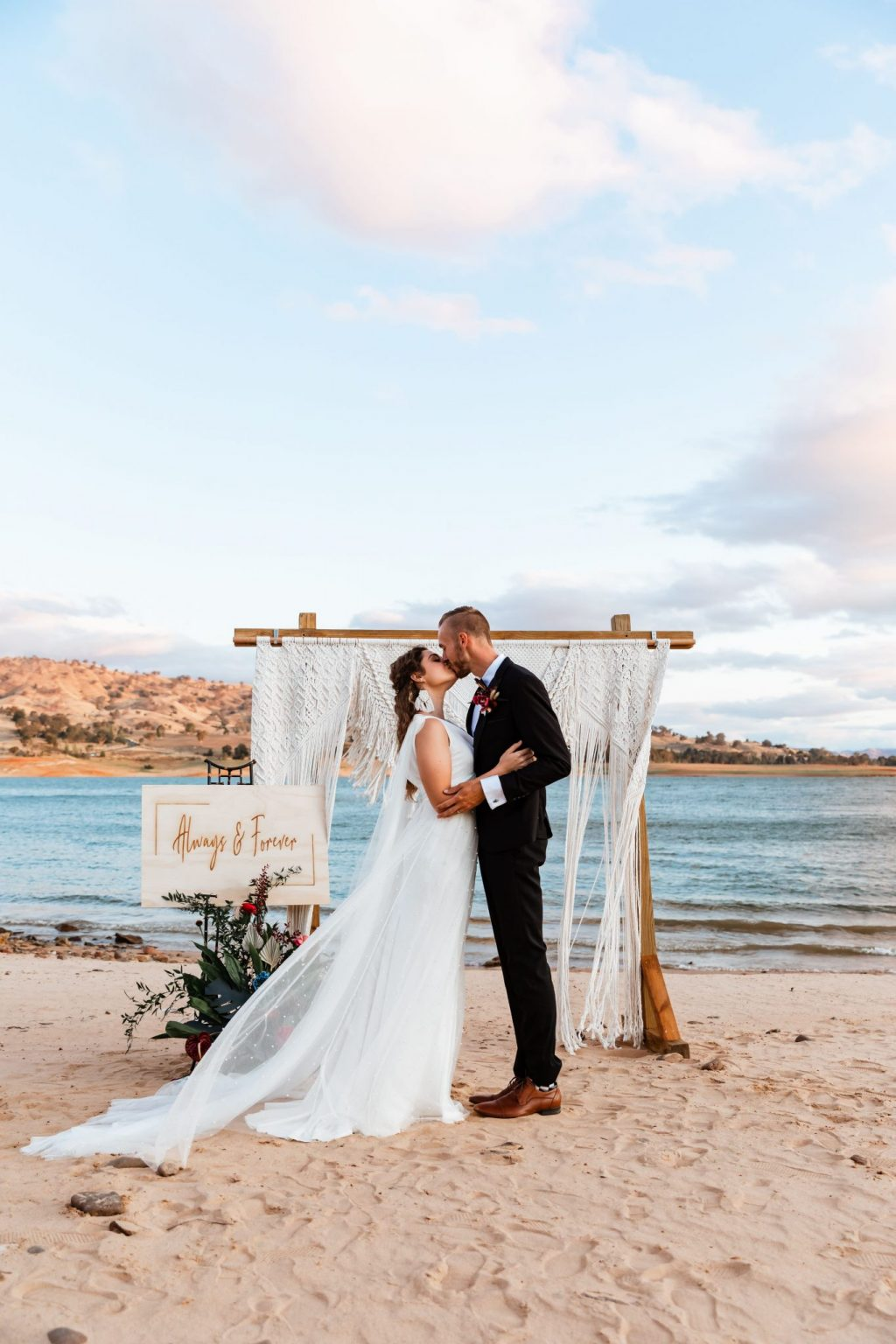 Wedding couple first kiss on the shores