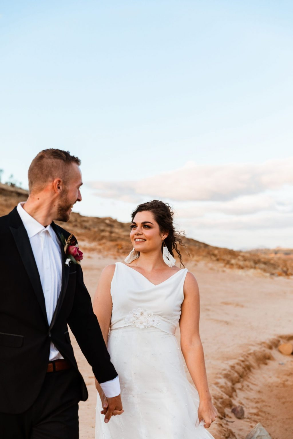 Wedding couple outside on the shores of the hume weir