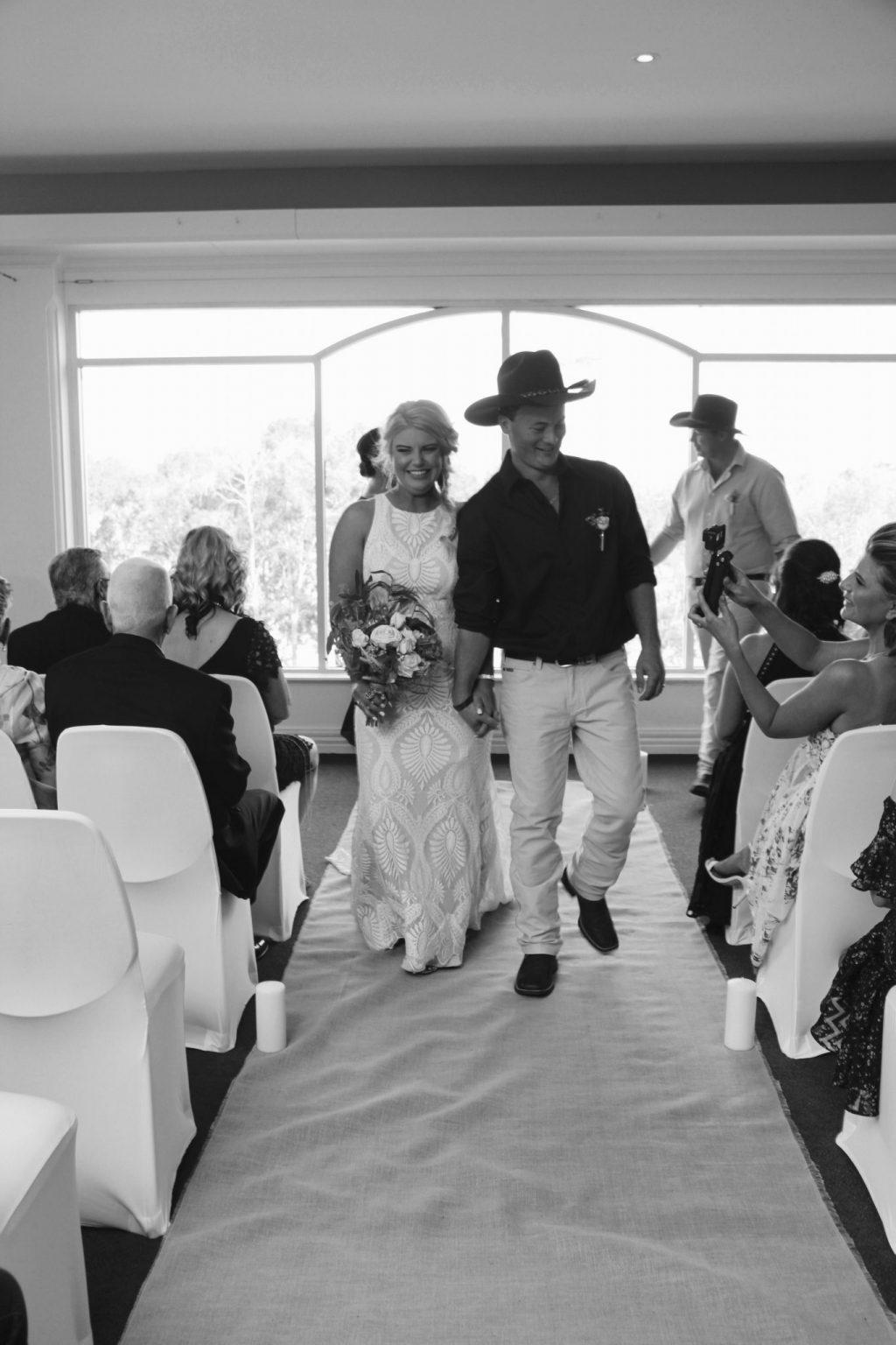 Wedding couple walking down the aisle